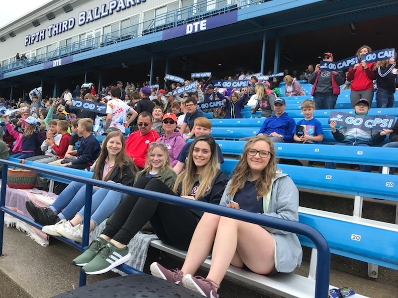 Some of our high school students and parents enjoying the baseball game!