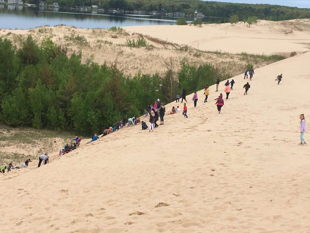 Students climbing Silver Lake sand dunes