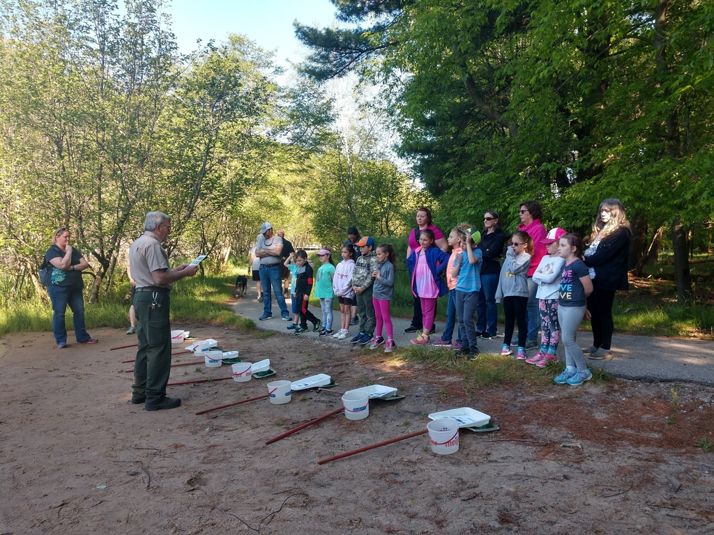 1st Grade students learning from Mr. Wernette at the Ludington State Park