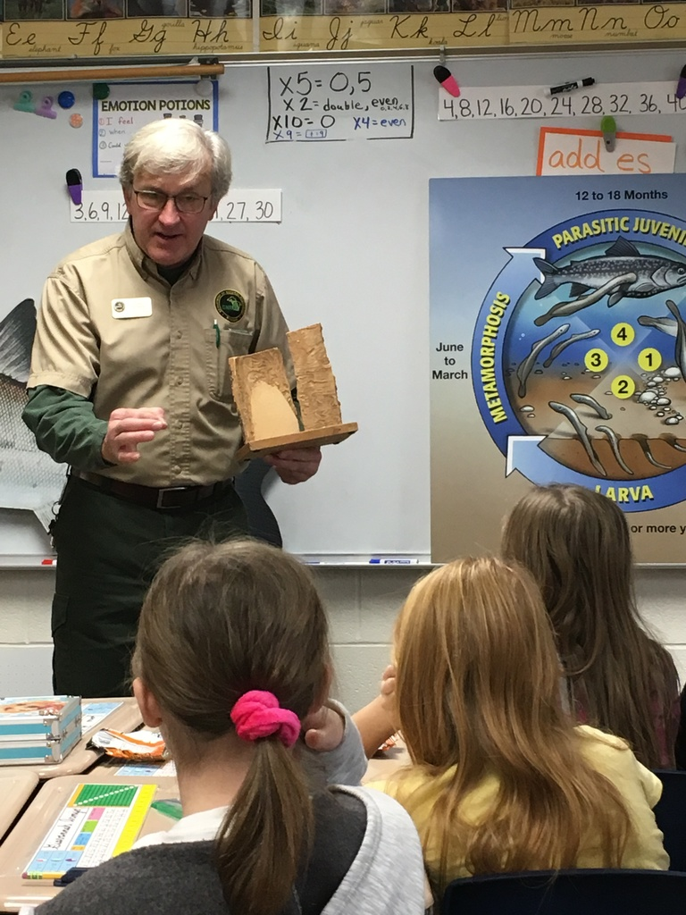 Mr. Wernette teaching 3rd grade students about invasive species